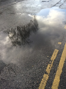 Pothole and yellow lines